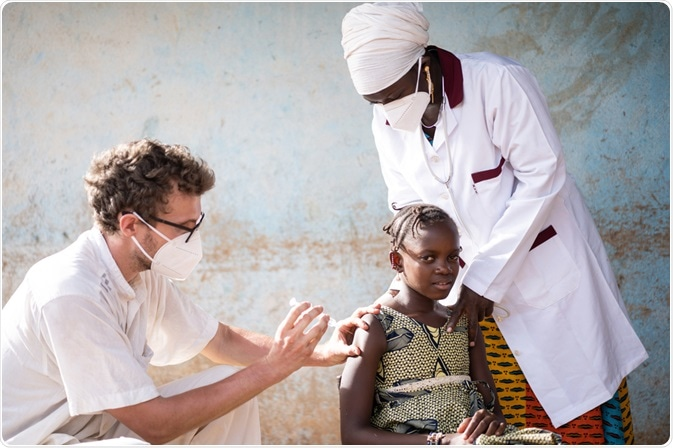 Doctor giving young child a vaccine