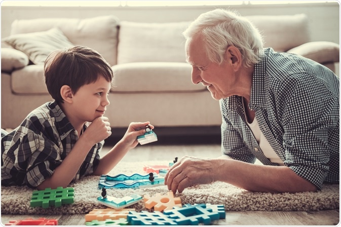 Boy playing with his grandfather