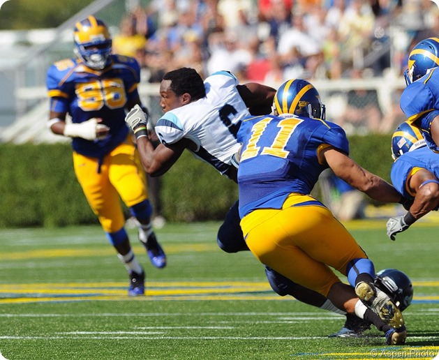 NEWARK, DE - OCTOBER 9 University of Maine running back Derrick Session (#6) runs away from defenders with the ball and without his helmet October 9, 2010 in Newark, DE