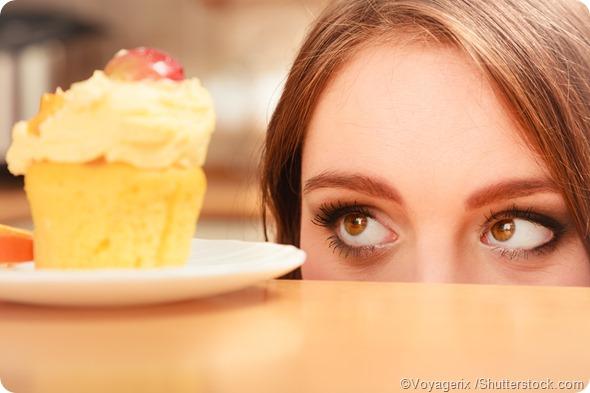 woman looking at cupcake