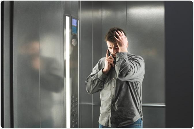 Claustophobia in the elevator. Image Credit: Bodnar Taras / Shutterstock