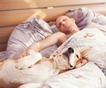 Your dog in your bed with you – is it good for your sleep?